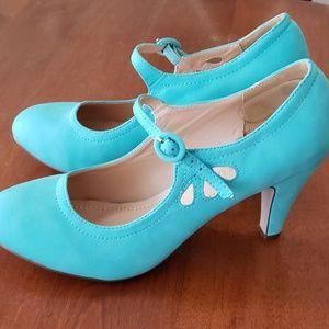 Chase + Chloe teal mary jane kitten heels.